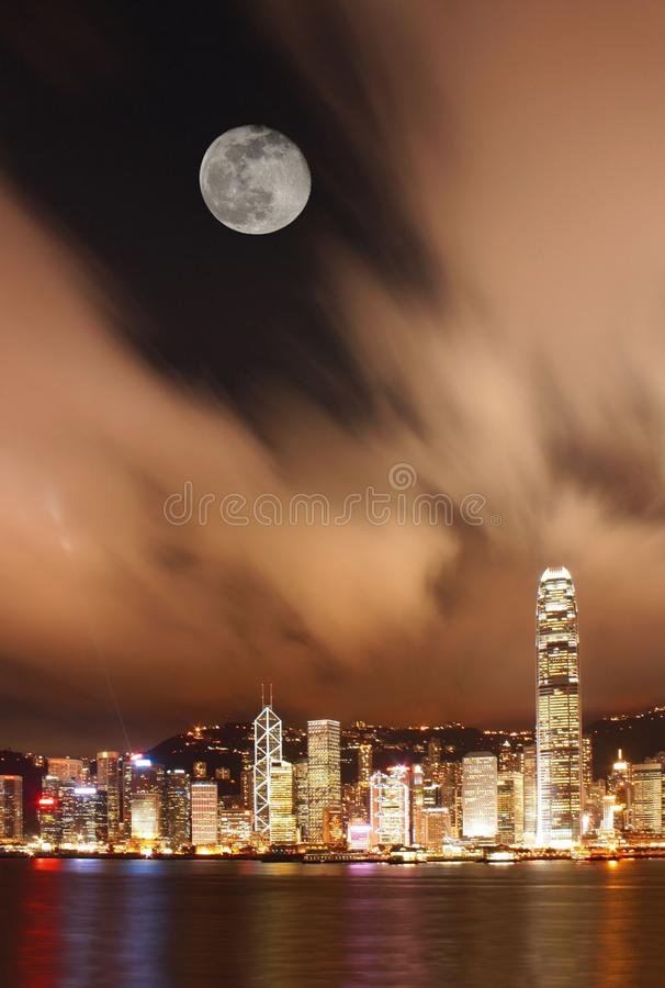 Night scene of Hong Kong Victoria Harbor. With full moon royalty free stock image