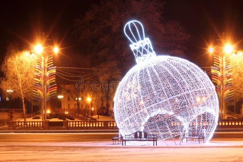 Night scene with illuminated Christmas balls stock photo