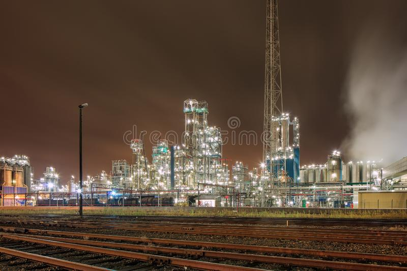 Night scene with illuminated petrochemical production plant and train tracks, Antwerp, Belgium. Night scene with illuminated petrochemical production plant and royalty free stock images