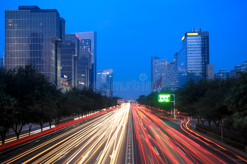 Night scene of modern beijing. Light trails on the street at dusk in beijing,China stock images