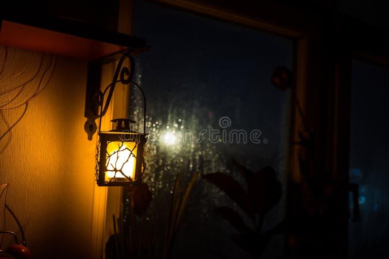 Night scene of stars seen through the window from dark room. Night sky inside dark room viewing from window with old vintage. Night scene of Moon seen through stock photography