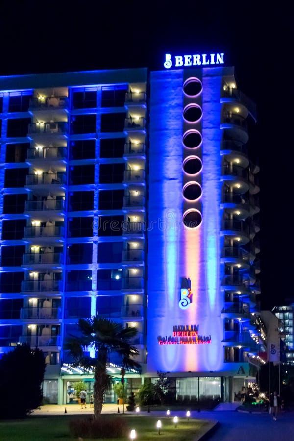 Night scene - neon lights and logo of Berlin Golden Beach hotel royalty free stock photos