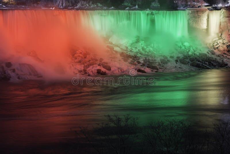 Night scene of Niagara Falls USA american, beautifully illuminated in red, green and yellow, winter scene royalty free stock image
