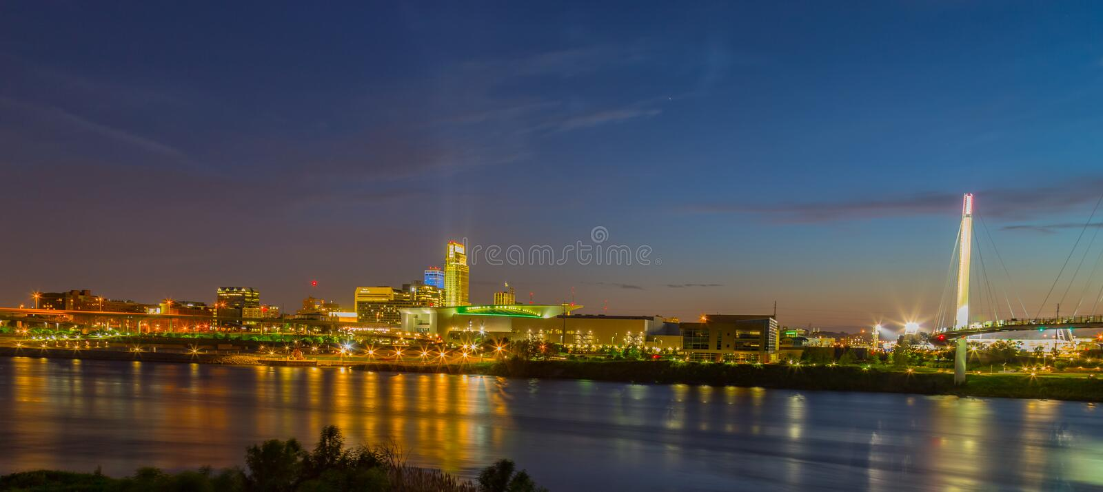 Night scene of Omaha waterfront with light reflections on the r Omaha Nebraska skyline with beautiful sky colors just after sunset stock images