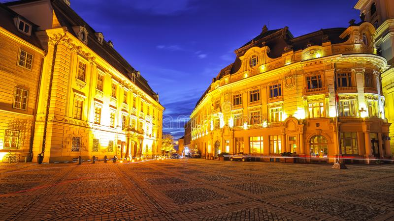 Night scene of Piata mare central square in historical Sibiu. Cityscape of Sibiu town, Transylvania, Romania, Europe stock photography