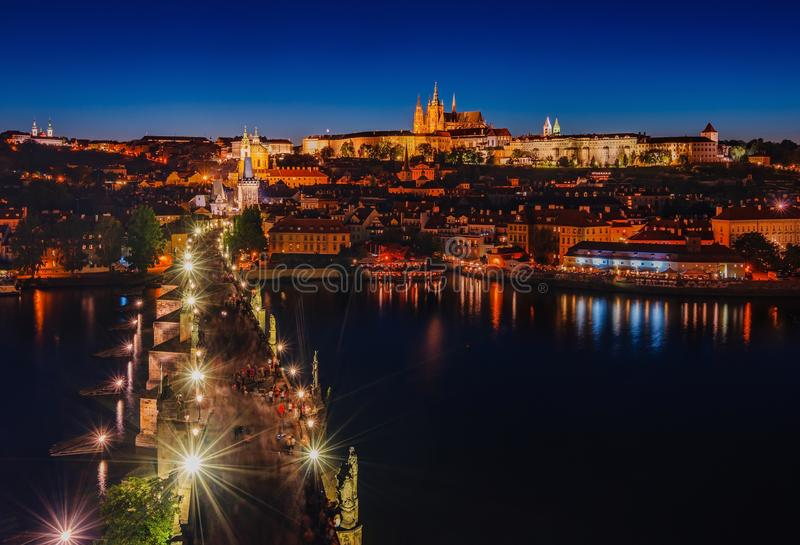 Night scene of Prague Castle and Charles Bridge. Night view of Charles Bridge and Prague Castle with St. Vitus Cathedral and St. George church, Bohemia landmark royalty free stock images