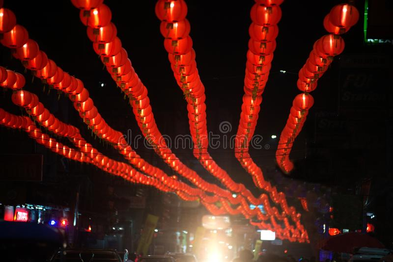 Night scene of red comp lamp lantern Chinese style hanging decorated in Chinese New Year Celebration in Thailand. royalty free stock photography