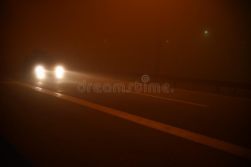 Night scene on the road with fog. And car royalty free stock photo