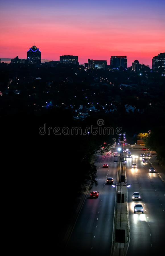 Night scene of road leading to city. royalty free stock photo