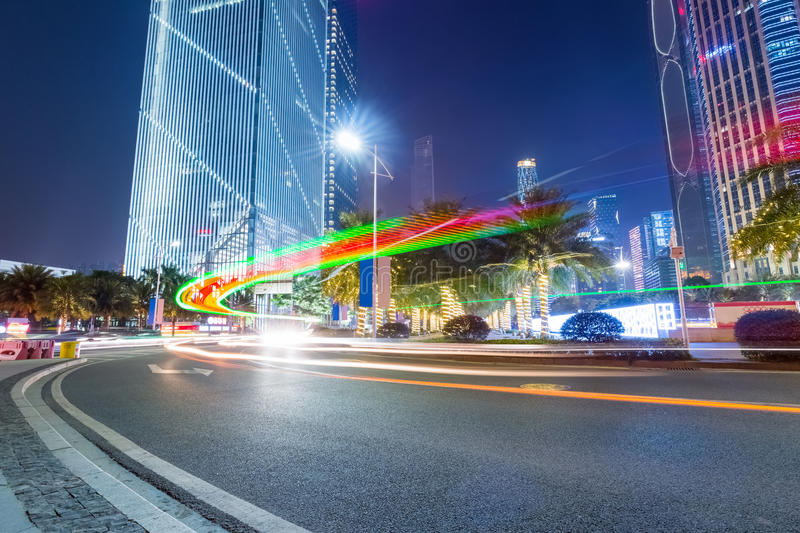 Night scene of road with modern buildings royalty free stock photography