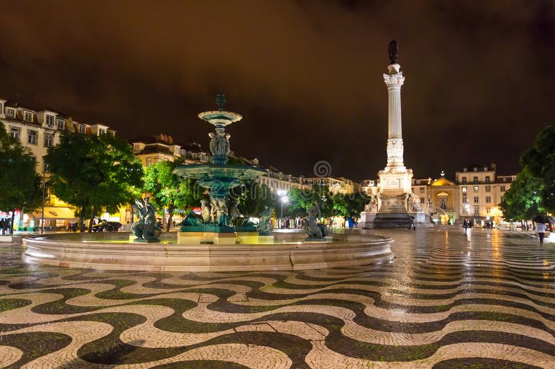 Night scene of Rossio Square, Lisbon, Portugal with one of its decorative fountains and the Column of Pedro IV stock image