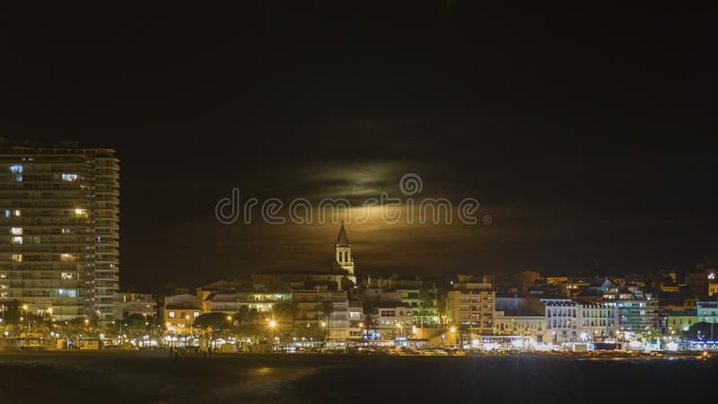 Night scene from a small mediterranean town Palamos in Spain.  royalty free stock photo