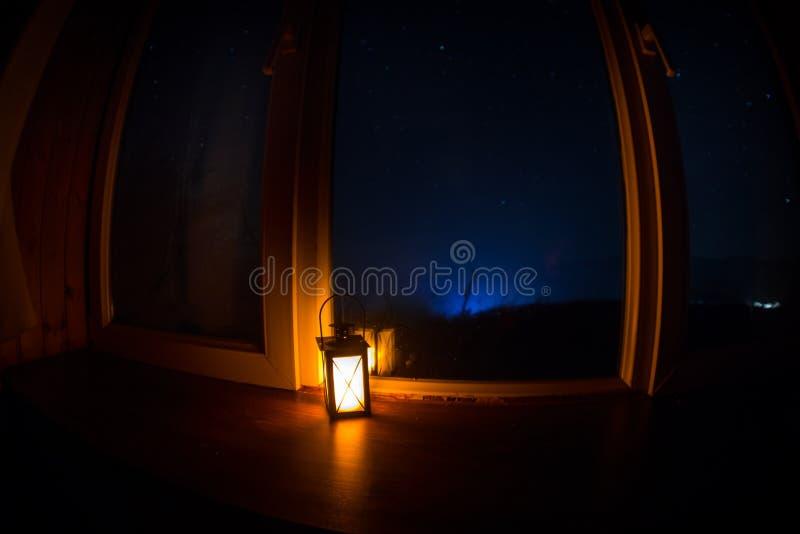Night scene of stars seen through the window from dark room. Night sky inside dark room. Long exposure shot. Night scene of stars seen through the window from stock image