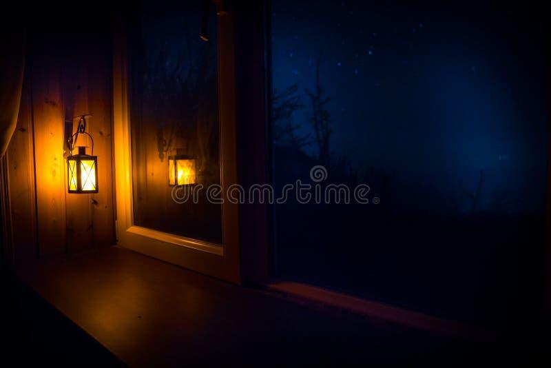 Night scene of stars seen through the window from dark room. Night sky inside dark room. Long exposure shot. Night scene of stars seen through the window from royalty free stock image
