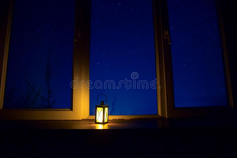 Night scene of stars seen through the window from dark room. Night sky inside dark room. Long exposure shot. Night scene of stars seen through the window from royalty free stock photo
