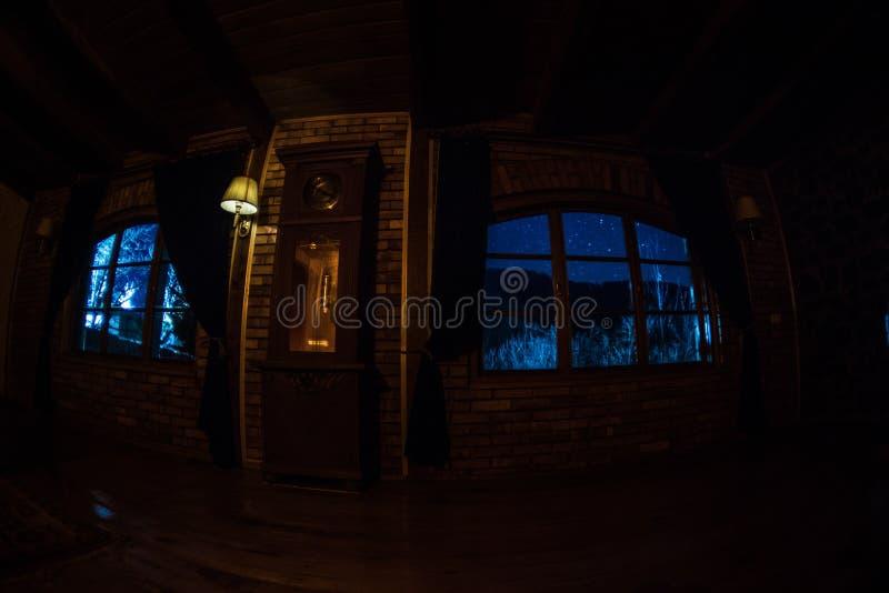 Night scene of stars seen through the window from dark room. Night sky inside dark room stock photo