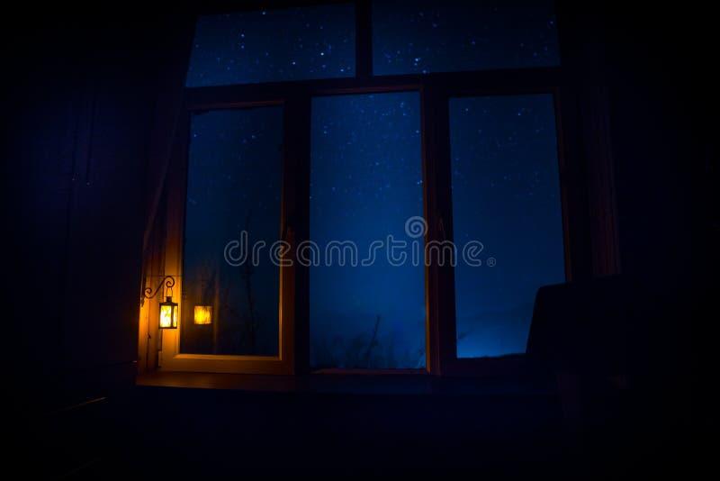 Night scene of stars seen through the window from dark room. Night sky inside dark room. Long exposure shot. Night scene of stars seen through the window from royalty free stock photos