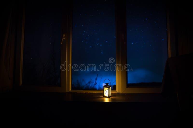 Night scene of stars seen through the window from dark room. Night sky inside dark room. Long exposure shot. Night scene of stars seen through the window from stock photos
