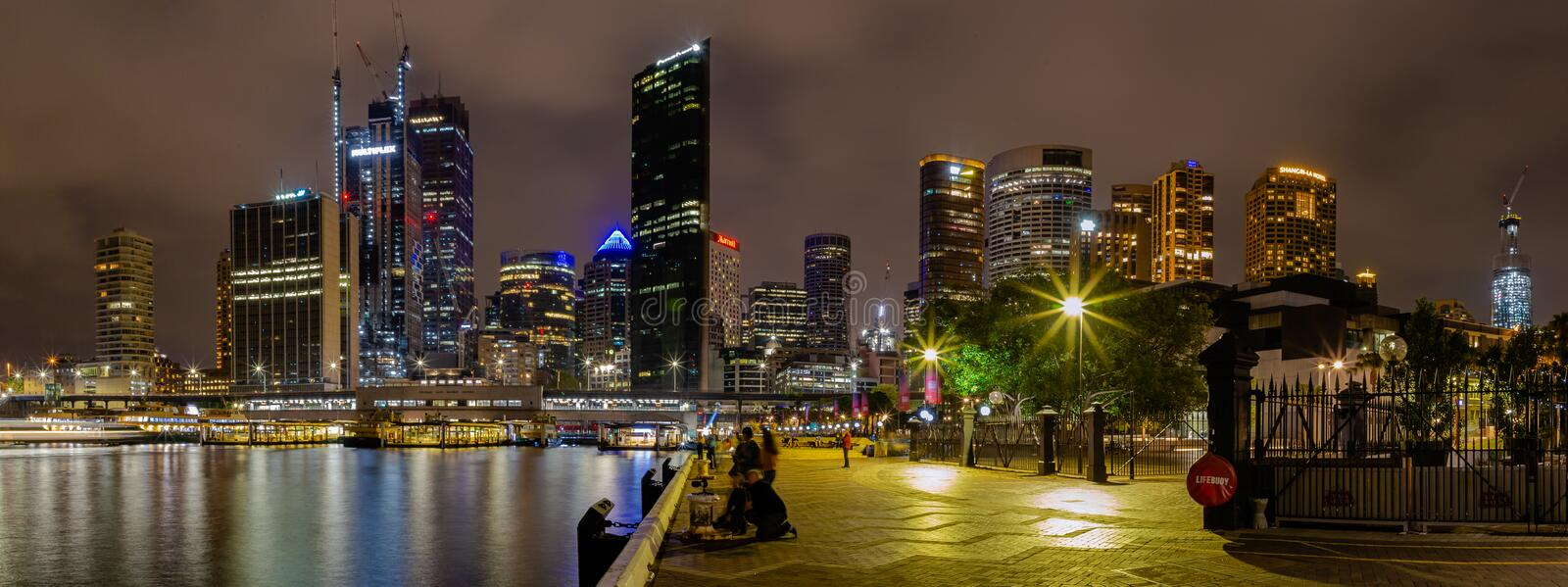 Night scene Sydney financial and hospitality buildings at the Circular Quay at Sydney Harbor New South Wales Australia. Smokey cloud this night might just be royalty free stock image