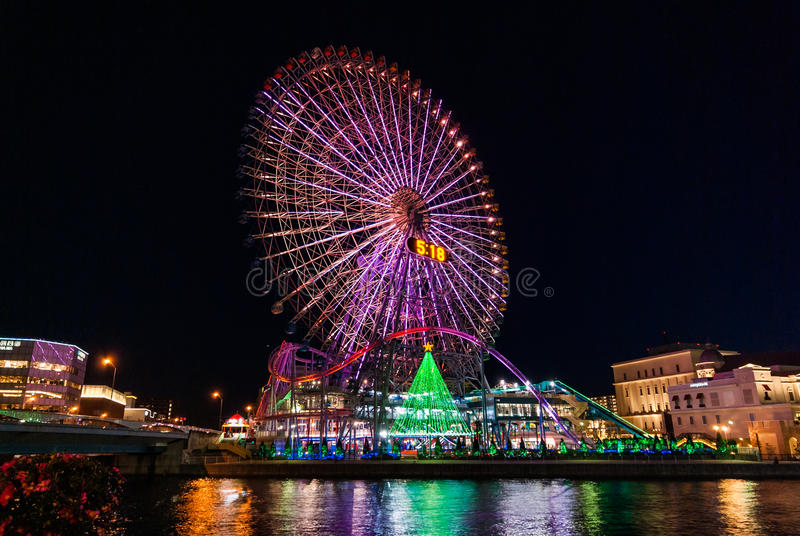 Night scene in Yokohama. Illuminated night scene of the Shinko area in the Minato Mirai 21 district of Yokohama, Japan including the Cosmo World amusement park stock photos