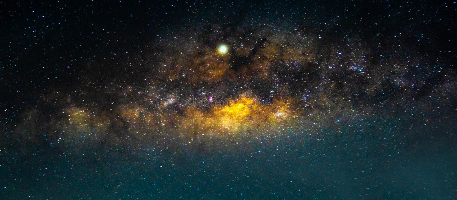 Night scenery with  colorful and light yellow Milky Way Full of stars in the sky in summer Beautiful universe Background of space. Night scenery with colorful royalty free stock photos
