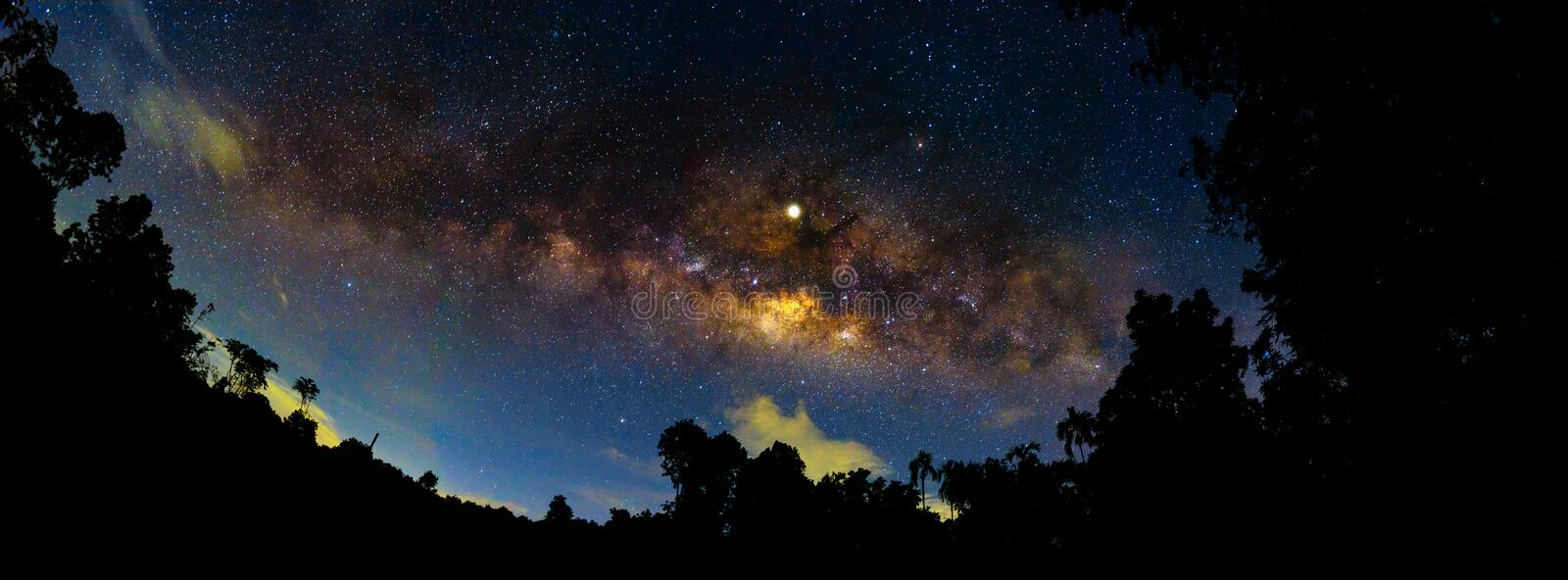 Night scenery  with colorful and light yellow Milky Way Full of stars in the sky in summer Beautiful universe Background of space. Night scenery with colorful stock photo