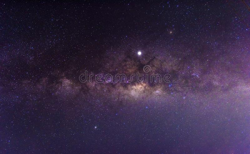 Night scenery with colorful and light yellow Milky Way Full of stars in the sky in summer Beautiful universe Background of space. Night scenery with colorful and royalty free stock image