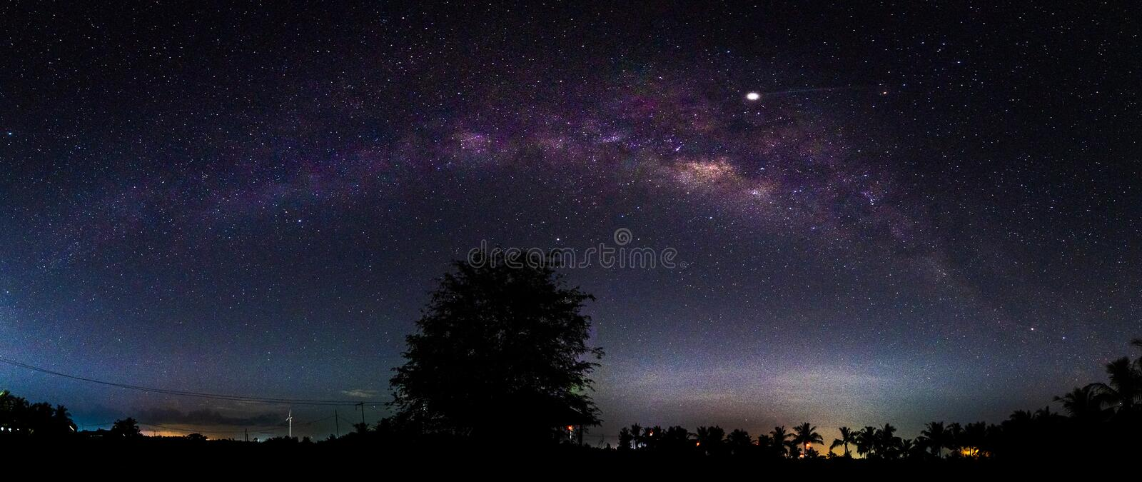 Night scenery with colorful and light yellow Milky Way Full of stars in the sky in summer Beautiful universe Background of space stock images