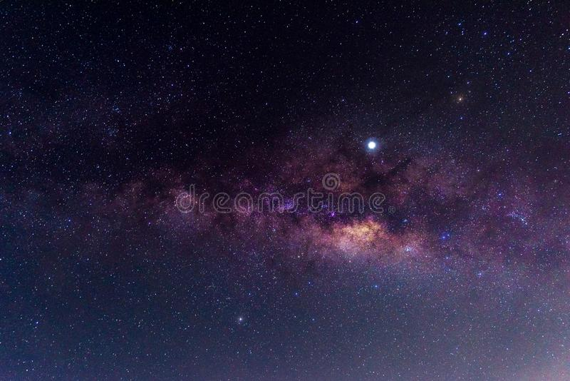Night scenery with colorful and light yellow Milky Way Full of stars in the sky in summer Beautiful universe Background of space. Night scenery with  colorful stock images