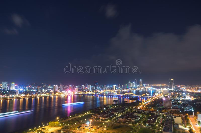 Night scenery of Da Nang city, Vietnam with the magic of light from the bridges, buildings and daydreaming part 2 royalty free stock image