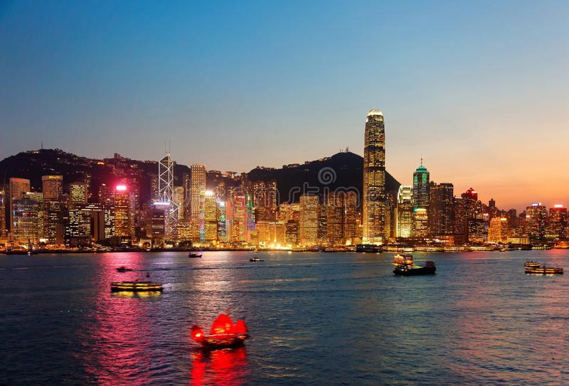 Night scenery of Hong Kong with a majestic skyline of crowded skyscrapers by Victoria Harbour. Colorful city lights glistening & reflected in the water and royalty free stock image