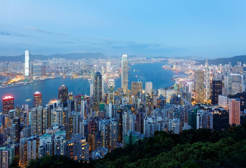 Night scenery of Hong Kong viewed from top of Victoria Peak with city skyline of crowded skyscrapers royalty free stock photography