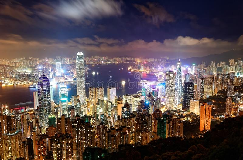 Night scenery of Hong Kong viewed from top of Victoria Peak with city skyline of crowded skyscrapers by Victoria Harbour. & Kowloon area across the busy seaport royalty free stock photography