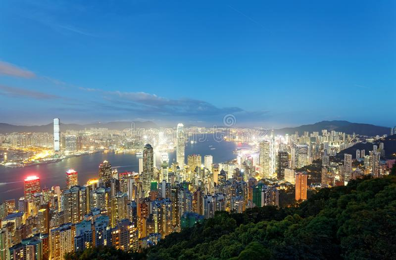 Night scenery of Hong Kong viewed from top of Victoria Peak with city skyline. Of crowded skyscrapers by Victoria Harbour & Kowloon area across seaport ! stock photos