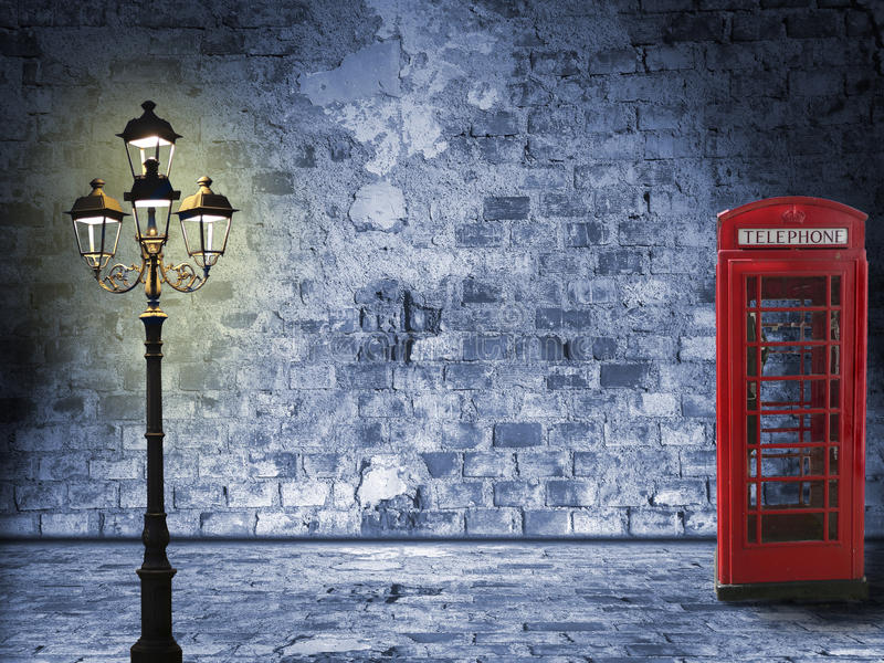 Night scenery in the London street. Vintage scenery, brick wall, lantern and phone box, night scenery in the street vector illustration