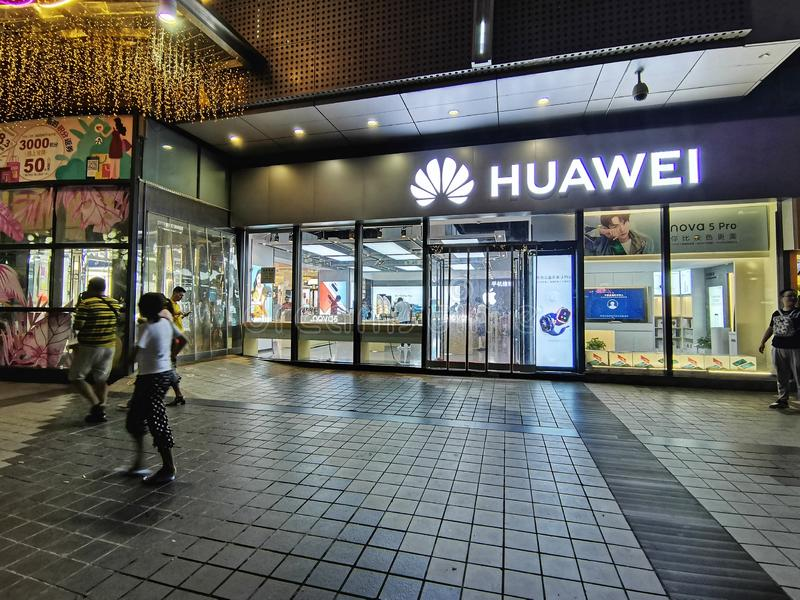 Night scenes of huawei cell phone store in wuha n city. Night scenes of huawei cell phone store in the downtown of wuhan city, hubei province, china stock photos