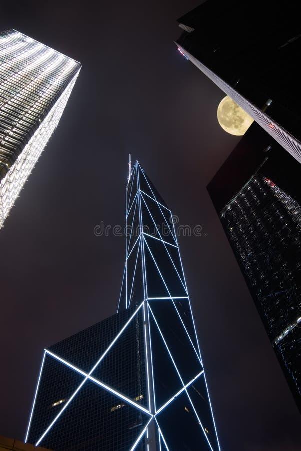 Night scenes of modern skyscraper with moon stock image