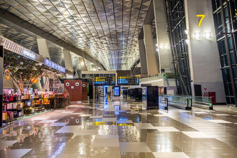 The Soekarno Hatta international airport of Jakarta Indonesia at terminal 3,A beautiful  architectural interior design. Night scenes of The Soekarno Hatta stock image