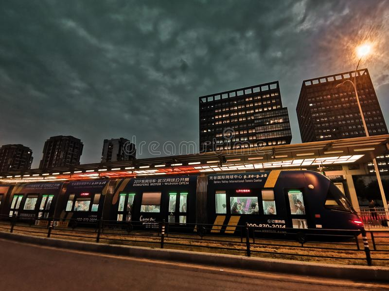 Night scenes of tram station in Wuhan city. Night scenes of tram station in the downtown of Wuhan city hubei province china stock photography