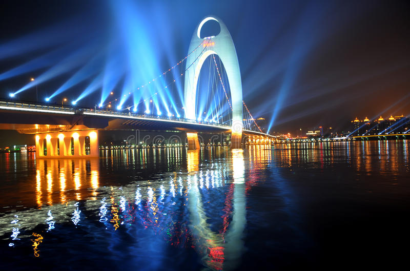 The night scenic of Guangzhou. A bridge with colorful neon light over the Pearl River stock photos