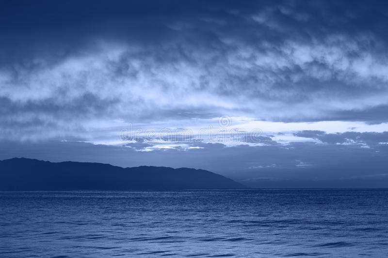 Night sea. Clouds over night sea background stock images