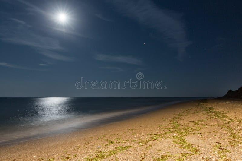 Night sea beach with moon royalty free stock photos