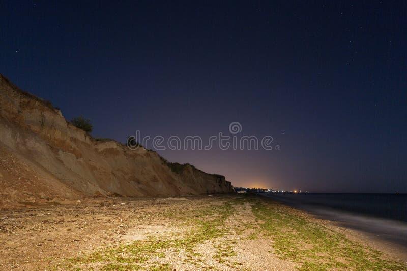 Night sea beach with stairs stock photos