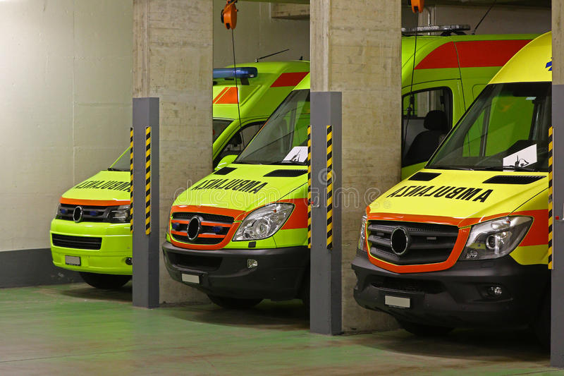 The night shift: ambulance service. Parked emergency vehicles during the night shift, EMT's are resting while the ambulances are ready stock image
