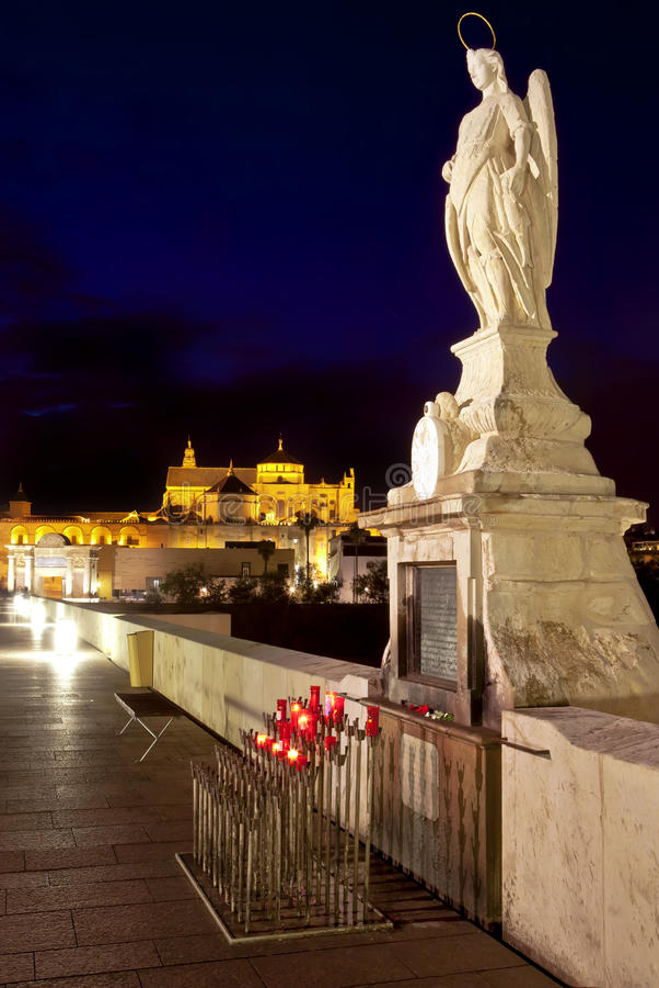 Download Night Shot Of Archangel Raphael Statue On Roman Bridge At Cordoba, Andalusia Stock Images - Image: 31491364