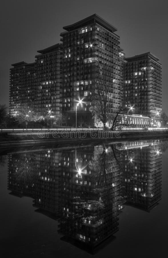 Night shot black and white cityscape in the autumn with artificial lights. In Bucharest on Dambovita River royalty free stock image