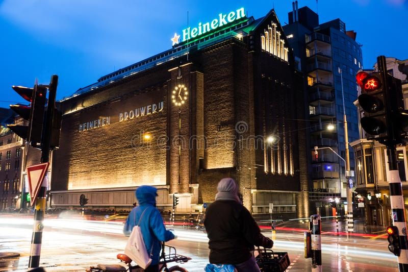 The Heineken experience in Amsterdam, The Netherlands. A night shot of the busy street scene outside the Heineken Experience in Amsterdam, The Netherlands royalty free stock photos