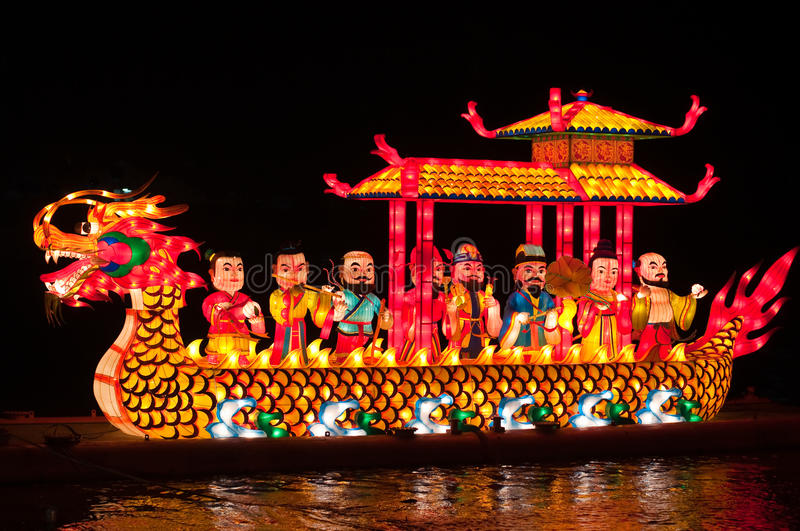 Night shot of dragon boat with lamp in river. Thailand royalty free stock photography