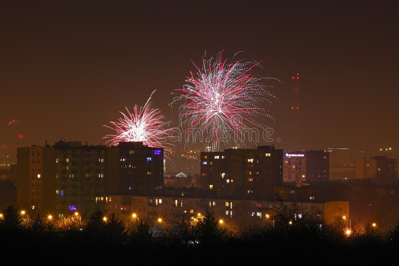Night shot of a fireworks over city. Poland, Kielce, The Holy Cross Mountains royalty free stock photography