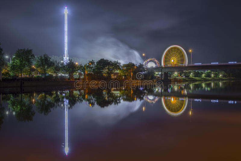 Night shot of folk festival with ferris wheel stock images